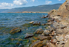 Cape uyuga. He rocky cliff . Maloe More Strait View, Cape Uyuga, Baikal lake Royalty Free Stock Images