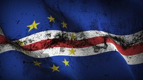 Cape Verde grunge dirty flag waving on wind. Cape Verde background fullscreen grease flag blowing on wind. Realistic filth fabric texture on windy day Stock Photo
