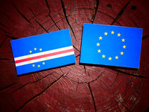 Cape Verde flag with EU flag on a tree stump isolated. Cape Verde flag with EU flag on a tree stump Royalty Free Stock Image