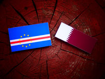 Cape Verde flag with Qatari flag on a tree stump isolated Royalty Free Stock Images
