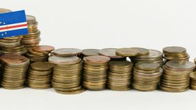 Cape Verde flag with stack of money coins. Cape Verde flag waving with stack of money coins stock footage