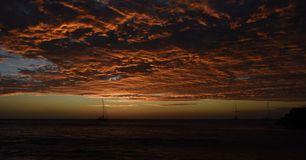 Cape Verde sunset with spectacular clouds and boat stock image