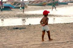 Little boy on the beach Stock Photos