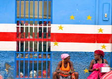 Cape Verdean women. In front of paint flag in Praia in the island of Santiago in the archipelago of Cape Verde stock images