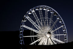 Cape Wheel. The ferris wheel at the V&A Waterfront in Cape Town, South Africa, a silhouette of Table Mountain in background stock images
