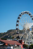 The Cape Wheel at the V&A Waterfront with Table Mountain in the Stock Photos