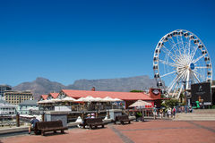 The Cape Wheel at the V&A Waterfront with Table Mountain in the Stock Photography