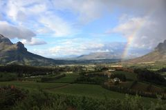 Cape Winelands. Photo taken of a beautiful farm with a rainbow in the Cape Winelands Royalty Free Stock Photo