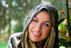 Caped beauty smiling. A beautiful smiling woman in garden wearing a traditional cape Stock Image