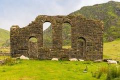 Capel Rhosydd, Wales, UK. The ruin of Capel Rhosydd near Blaenau Ffestiniog, Gwynedd, Wales, UK - with some sheep resting Royalty Free Stock Photos