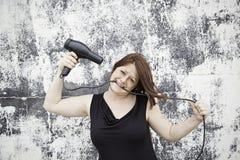 Capelli di secchezza della donna Fotografie Stock Libere da Diritti
