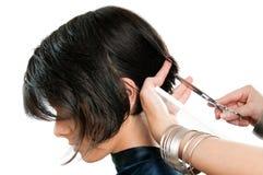 Capelli di taglio del parrucchiere Fotografia Stock