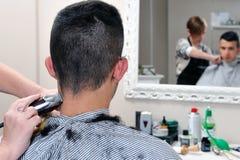 Capelli tagliati al barbiere fotografia stock libera da diritti