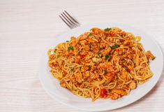 Capellini pasta with tomato and meat sauce Royalty Free Stock Images