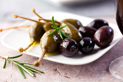 Caper berries and black olives Royalty Free Stock Images