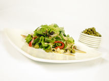 Caper salad. Fresh mixed salad with capers royalty free stock photo