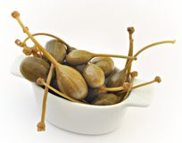 Capers. Put one over the other isolated on white background Royalty Free Stock Photos