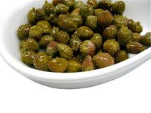 Capers. Bowl of fresh delicious green capers isolated on white background Stock Photo