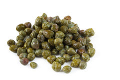 Capers. In close-up, casting soft shadow on white surface Royalty Free Stock Images
