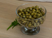 Capers. In the bowl with green leaves Royalty Free Stock Photography