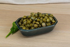 Capers. In the bowl with green leaves Stock Images