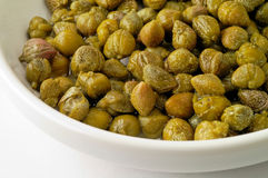 Capers in dish Royalty Free Stock Image