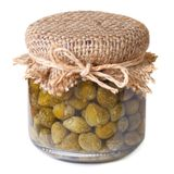 Capers in a glass jar closeup isolated on white background Royalty Free Stock Images