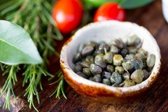 Capers and herbs. Selective focus. Close up Royalty Free Stock Photos