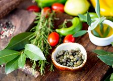 Capers and herbs. Selective focus. Close up Stock Photos