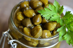 Capers in a jar. Royalty Free Stock Images