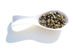 Capers in salt Stock Images