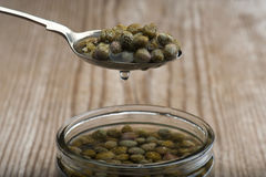 Capers On Spoon Royalty Free Stock Photo