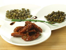 Capers, tomatoes and pepper Stock Image