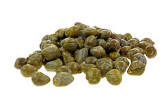 Capers on White. A group of drained pickled capers on white Royalty Free Stock Photo