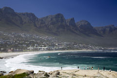 A Capetown beach and Table Mountain. A beach in Capetown with the 12 Apostles of the Table Mountain in the background Royalty Free Stock Photos