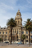 Capetown Town House. The facade of the historical town house with its clock tower and palm trees in downtown Capetown, South Africa stock photography