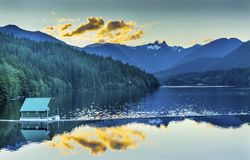 Free Capilano Reservoir Lake Snowy Two Lions Mountains Vancouver Brit Stock Photos - 102877813