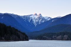 Capilano River and the lions mountain Royalty Free Stock Images