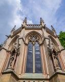 Capilla de la universidad del ` s de St John, iglesia de la capilla de Cambridge, Inglaterra - Calvary foto de archivo