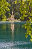 Capilla en bosque con un lago Fotos de archivo
