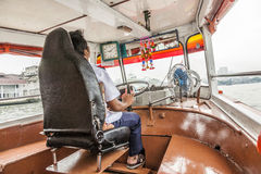 Capitain of ferrry boat in Bangkok, Thailand Royalty Free Stock Photography