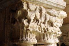 Capital 3. Capital on a column in a monastery La Colegiata of Cathedral Santillana del Mar, Cantabria stock photo