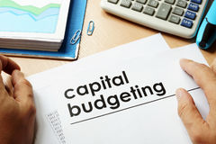 Capital budgeting. Papers with title capital budgeting stock image