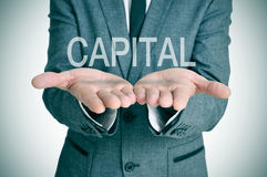 Capital in a businessman hands. The word capital in the open hands of a businessman Royalty Free Stock Photo