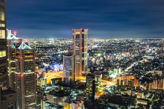 Tokyo Skyline at Night with Neon Lights Illuminating Buildings a royalty free stock images