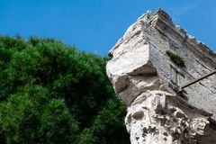 Capital of the column of an ancient Roman temple royalty free stock photography