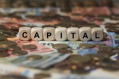 Capital - cube with letters, money sector terms - sign with wooden cubes. Series of cube with letters from money sector Royalty Free Stock Images