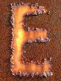 Capital E. A faded peeling capital letter E on a old rusty Royalty Free Stock Photo
