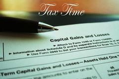 Capital Gains & Loses Tax Form Close Up With Lomo Effect High Quality