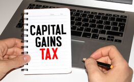 Capital gains tax-text label in the form of a document Registrar planning folder.